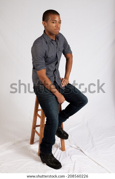 Sensational Handsome Black Man Sitting On Wooden Stock Photo Edit Now Ocoug Best Dining Table And Chair Ideas Images Ocougorg