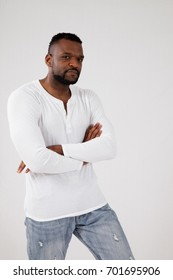 Handsome black man in white shirt looking thoughtful