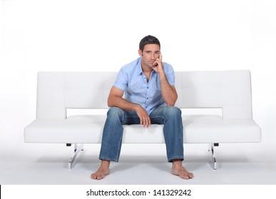 handsome bloke sitting on sofa
