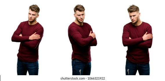 Handsome blond man irritated and angry expressing negative emotion, annoyed with someone isolated over white background