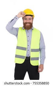 Handsome blonde beard young engineer smiling and holding his helmet, guy wearing gray shirt and black pants with a yellow vest, isolated on white background