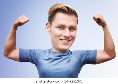handsome blonde man with big head flexing his muscles