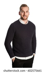 Handsome blonde man standing against a white background wearing a black sweater with a white shirt underneath. Standing against a white background.