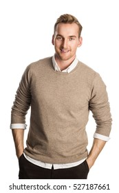 Handsome blonde man wearing a brown pullover and white shirt, standing smiling against a white background.