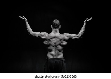 handsome bodybuilder man or sexy muscular guy with athlete body and back training and posing, black and white