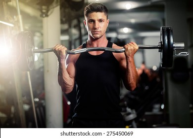 handsome bodybuilder works out  weights excercise in gym