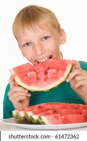 handsome boy eating watermelon on a white background