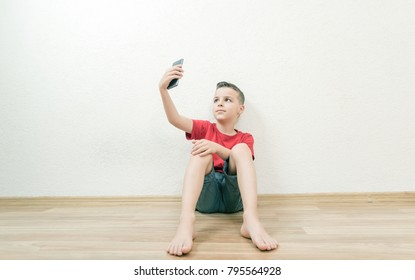 handsome boy holds a mobile phone