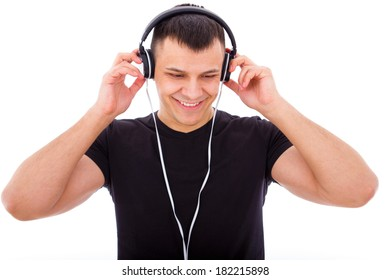 handsome boy listening to music with headphones smiling