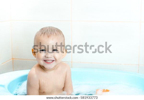 Handsome boy preschooler bathing in the bathroom clean and hygienic