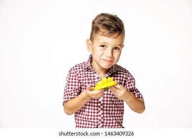 handsome boy in a red shirt is eating a mango on a white background