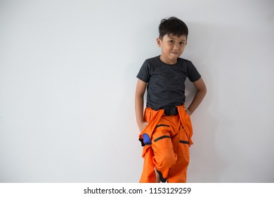 Handsome boy rest as a astronout look camera on white background