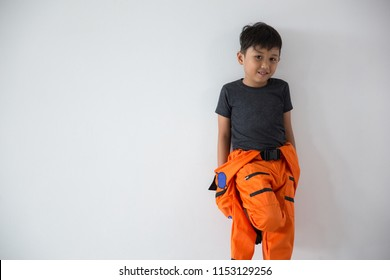 Handsome boy rest as a astronout on white background