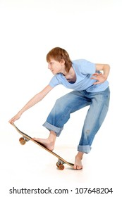 Handsome boy riding a skateboard on a white background
