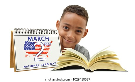 Handsome boy smiling looking at camera behind National Read Day march 2 calendar open book white background