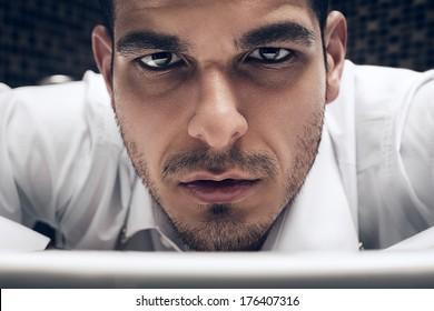 handsome brown eyed man in shirt