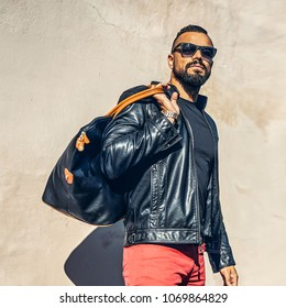 Handsome brutal beard man with bag - outdoor fashion