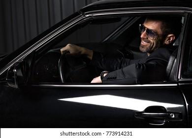 Handsome brutal man in the car
