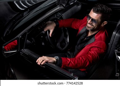 Handsome brutal man in the car