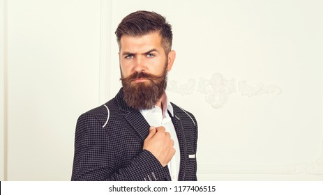 Handsome brutal man suit, tailor in his workshop. Handsome bearded fashion man in classical black costume suit. Amazing style. Men with beard clothing, boutiques. Tailor, tailoring. Stylish men's suit