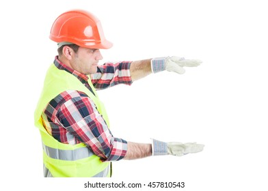 Handsome builder holding something on his palms with copyspace or text area isolated on white background
