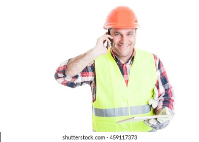 Handsome builder holding tablet and calling somebody on cellphone isolated on white background with text area