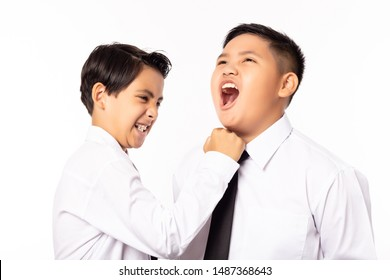 Handsome  business boy punch fat boy, plump boy always bullies him sometimes, he can not patient with him. Little guy revenge by punching at enemy face. Young boy hate friend a lot. Isolated on white