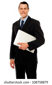 Handsome business executive holding laptop isolated against white background