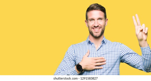 Handsome business man with blue eyes Swearing with hand on chest and fingers, making a loyalty promise oath