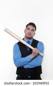 Handsome business man holding a baseball bat looking a bit hard