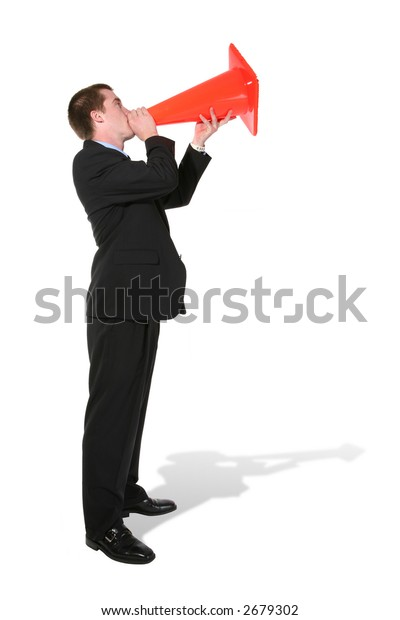 A handsome business man making an announcement through a construction cone