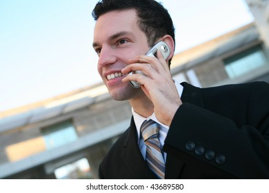 A handsome business man at the office on cell phone