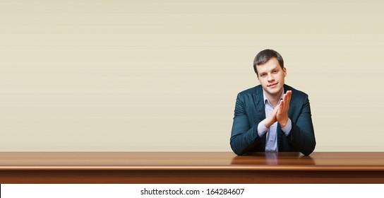 handsome business man on a desk