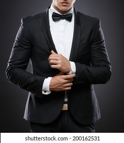 handsome business man in suit on a dark background