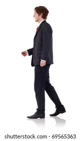 Handsome business man walking, over white background