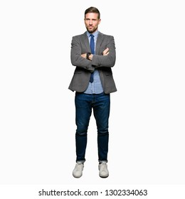 Handsome business man wearing suit and tie skeptic and nervous, disapproving expression on face with crossed arms. Negative person.