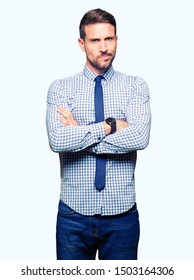Handsome business man wearing tie skeptic and nervous, disapproving expression on face with crossed arms. Negative person.
