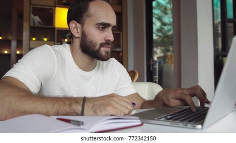 Handsome business man working at laptop computer