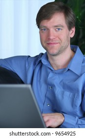 Handsome business man working on laptop