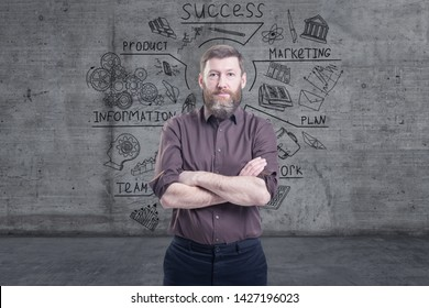 Handsome businessman against a concrete wall with sketch drawn on it