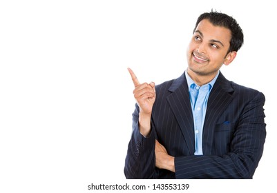Handsome businessman or attorney or politician pointing to copy space at left, waist length picture, isolated on white background