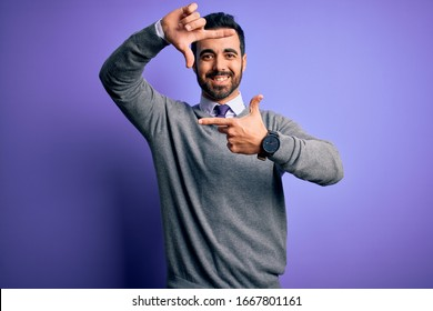 Handsome businessman with beard wearing casual tie standing over purple background smiling making frame with hands and fingers with happy face. Creativity and photography concept.