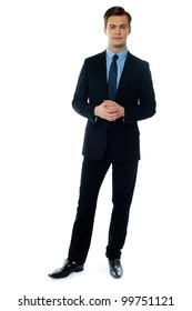 Handsome businessman in black suit posing against white background