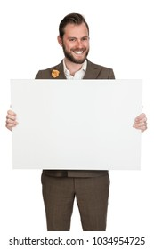 Handsome businessman in a brown suit with a white shirt, holding a blank board with a big smile on his face. White background.