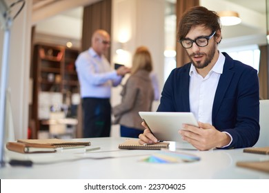 Handsome businessman in casual networking on background of his partners