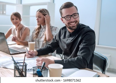 handsome businessman checking business documents . business concept