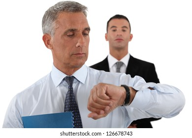 handsome businessman checking his watch