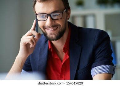 Handsome businessman consulting clients on the phone