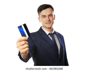 Handsome businessman with credit card, isolated on white