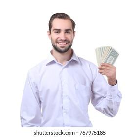 Handsome businessman with dollar bills on white background